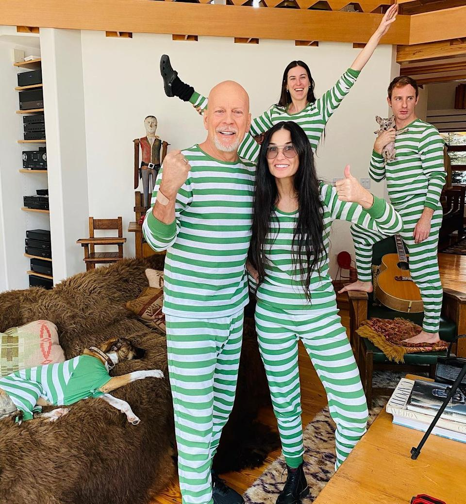 Bruce Willis Tallulah Willis and Demi Moore wearing matching green and white onsies