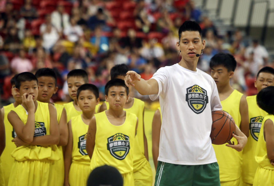 Former Toronto Raptors' Jeremy Lin, currently a free agent, talks to young Taiwanese players during a basketball clinic in Taipei, Taiwan, Saturday, July 27, 2019. Lin is in Taiwan to attend a charity event and basketball clinics for young athletes. (AP Photo/Chiang Ying-ying)