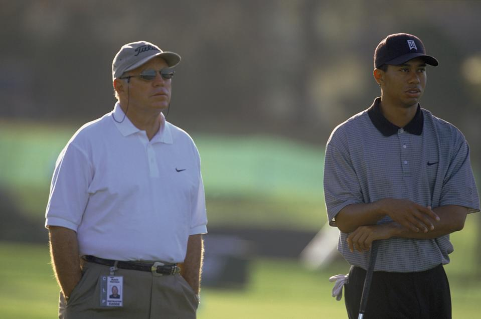 Tiger Woods and his coach Butch Harmon stand on the green during the Bay Hill Classic at the Bay Hill Lodge & G.C. in Orlando, Florida.