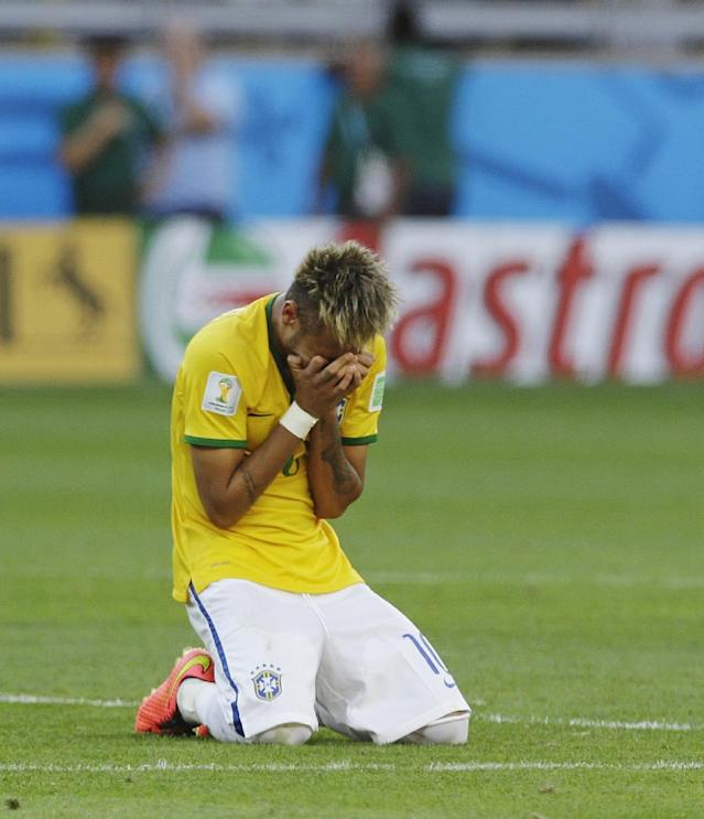 Brazil's Neymar reacts after a penalty shootout following regulation time during the World Cup round of 16 soccer match between Brazil and Chile at the Mineirao Stadium in Belo Horizonte, Brazil, Saturday, June 28, 2014. Brazil won 3-2 on penalties after a 1-1 tie. (AP Photo/Ricardo Mazalan)