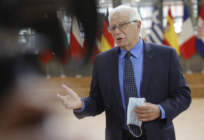 European Union foreign policy chief Josep Borrell speaks with the media as he arrives for a meeting of EU foreign ministers at the European Council building in Brussels, Monday, May 10, 2021. EU Foreign Affairs Ministers meet in Brussels to discuss current affairs, tensions with Russia, the Western Balkans, transatlantic relations and Belarus. (AP Photo/Olivier Matthys, Pool)
