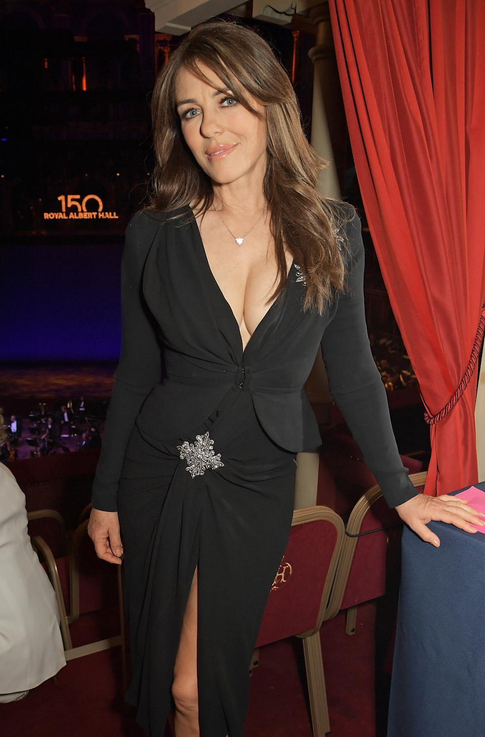 Elizabeth Hurley wears a plunging black dress at the inaugural British Ballet Charity Gala presented by Dame Darcey Bussell at The Royal Albert Hall on June 03, 2021 in London, England