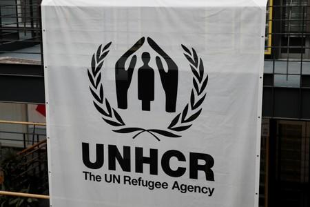 A logo is pictured on a banner at the UNHCR headquarters in Geneva