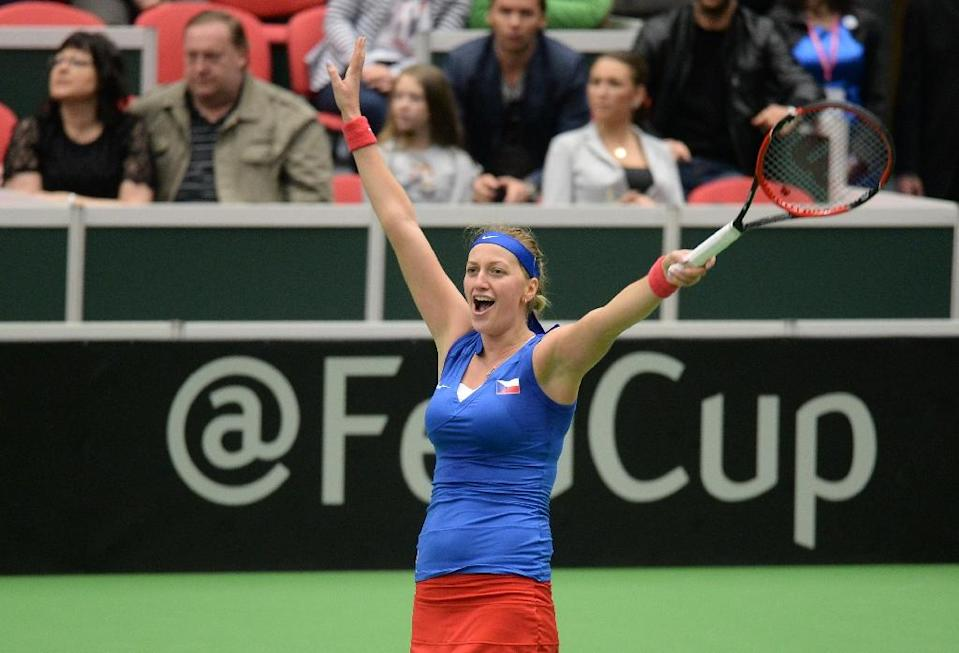 Petra Kvitova of the Czech Republic reacts after defeating Caroline Garcia of France in their Fed Cup semi-final in Ostrava match on April 19, 2015 (AFP Photo/Michael Cizek)