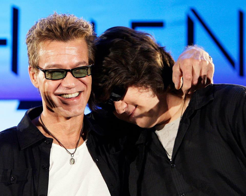 Eddie Van Halen, left, embraces son Wolfgang at a news conference in Los Angeles in 2007.
