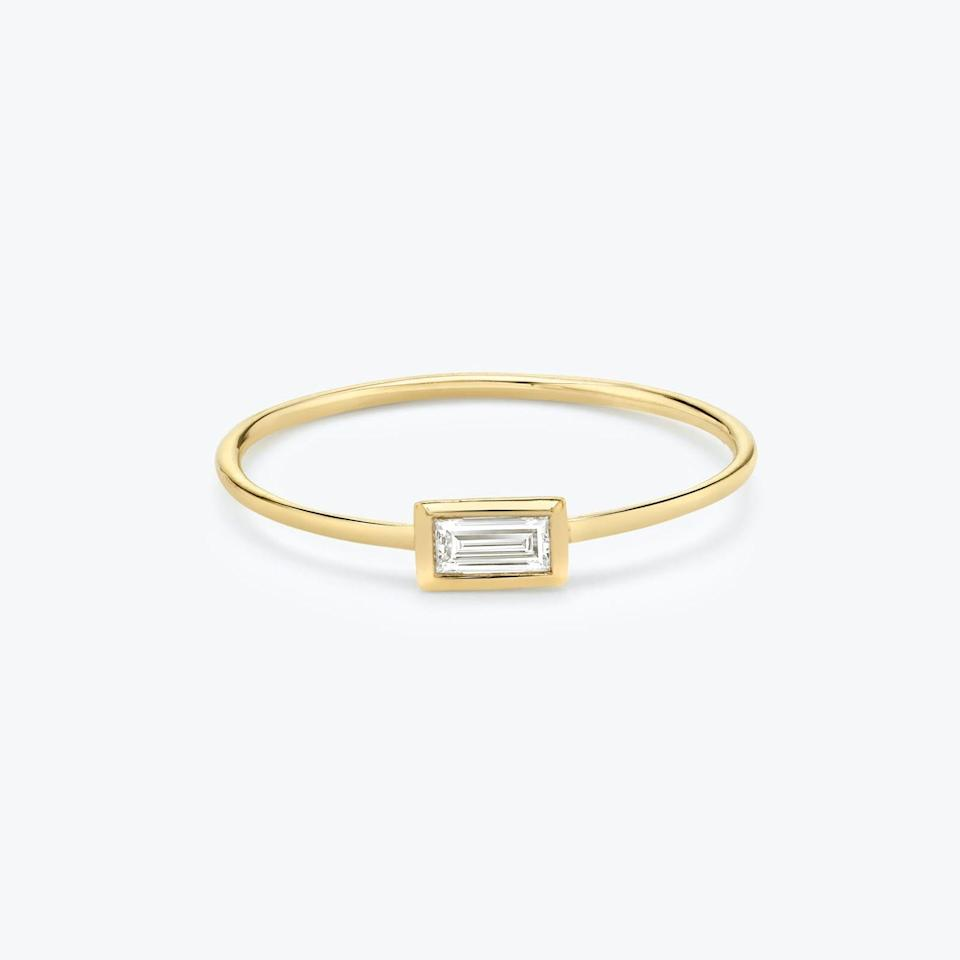 """East-west settings continue to gain traction among brides-to-be, according to Zimmermann: """"It's a modern feel with a contemporary approach on a solitaire classic."""" She says oval and emerald-cut diamonds work well in this type of ring. $285, Vrai. <a href=""""https://www.vrai.com/jewelry/rings/baguette-diamond-bezel-ring"""" rel=""""nofollow noopener"""" target=""""_blank"""" data-ylk=""""slk:Get it now!"""" class=""""link rapid-noclick-resp"""">Get it now!</a>"""