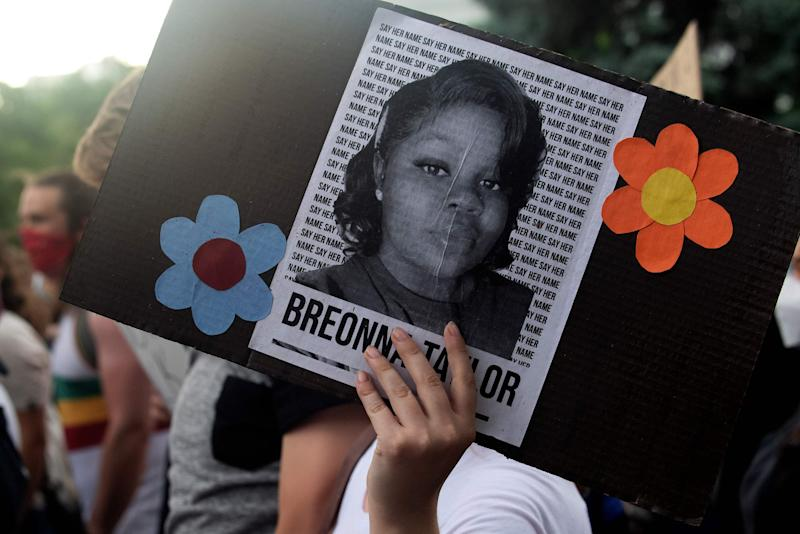 A demonstrator holds a sign with the image of Breonna Taylor, a black woman who was fatally shot by Louisville Metro Police Department officers, during a protest against the death George Floyd in Minneapolis, in Denver, Colorado on June 3, 2020. - US protesters welcomed new charges brought Wednesday against Minneapolis officers in the killing of African American man George Floyd -- but thousands still marched in cities across the country for a ninth straight night, chanting against racism and police brutality. (Photo by Jason Connolly / AFP) (Photo by JASON CONNOLLY/AFP via Getty Images)