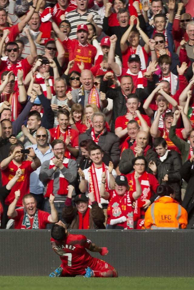 Liverpool's Luis Suarez celebrates with fans after scoring against Tottenham during their English Premier League soccer match at Anfield Stadium, Liverpool, England, Sunday March 30, 2014. (AP Photo/Jon Super)