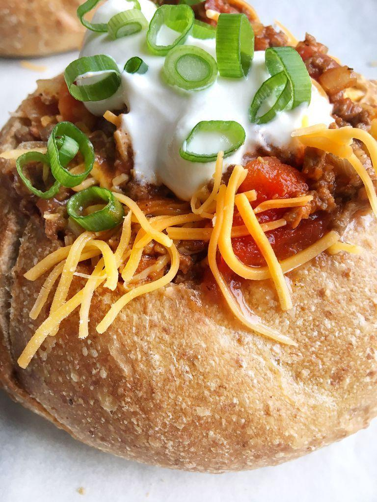 "<p>Bonus points if your bread bowl is <a href=""https://www.goodhousekeeping.com/food-recipes/party-ideas/a36687/football-shaped-bread-bowl-for-dip/"" rel=""nofollow noopener"" target=""_blank"" data-ylk=""slk:shaped like a football"" class=""link rapid-noclick-resp"">shaped like a football</a>.</p><p><em><a href=""https://www.delish.com/cooking/recipe-ideas/recipes/a51075/beef-chili-in-a-bread-bowl-recipe/"" rel=""nofollow noopener"" target=""_blank"" data-ylk=""slk:Get the recipe from Delish »"" class=""link rapid-noclick-resp"">Get the recipe from Delish »</a></em></p>"