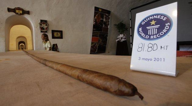 "The world's longest cigar that stretched 268 feet 4 inches (81.8 metres), or most of the length of a football field, is seen in Havana May 3, 2011. Resting on tables, it sprawled through El Morro, an old Spanish fort overlooking Havana Bay, where Cuba is holding its annual International Tourism Fair. The cigar, once it is officially accepted by Guinness World Records in London, will eclipse the previous record cigar of 148 feet 9 inches (45.38 metres), both rolled by Jose Castelar Cairo, better known as ""Cueto"". REUTERS/Desmond Boylan"