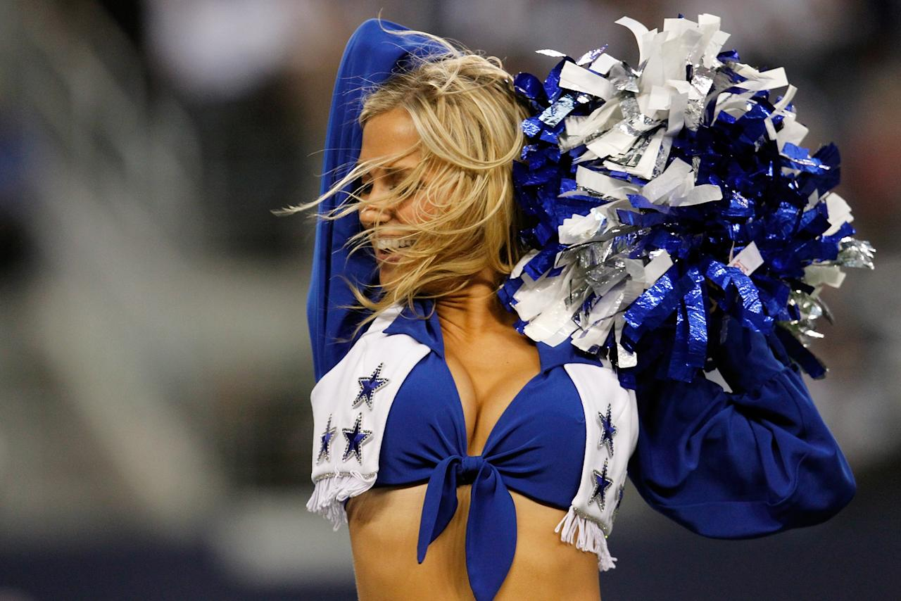 ARLINGTON, TX - NOVEMBER 22:  A Dallas Cowboys Cheerleader performs as the Dallas Cowboys take on the Washington Redskins on Thanksgiving Day at Cowboys Stadium on November 22, 2012 in Arlington, Texas.  (Photo by Tom Pennington/Getty Images)