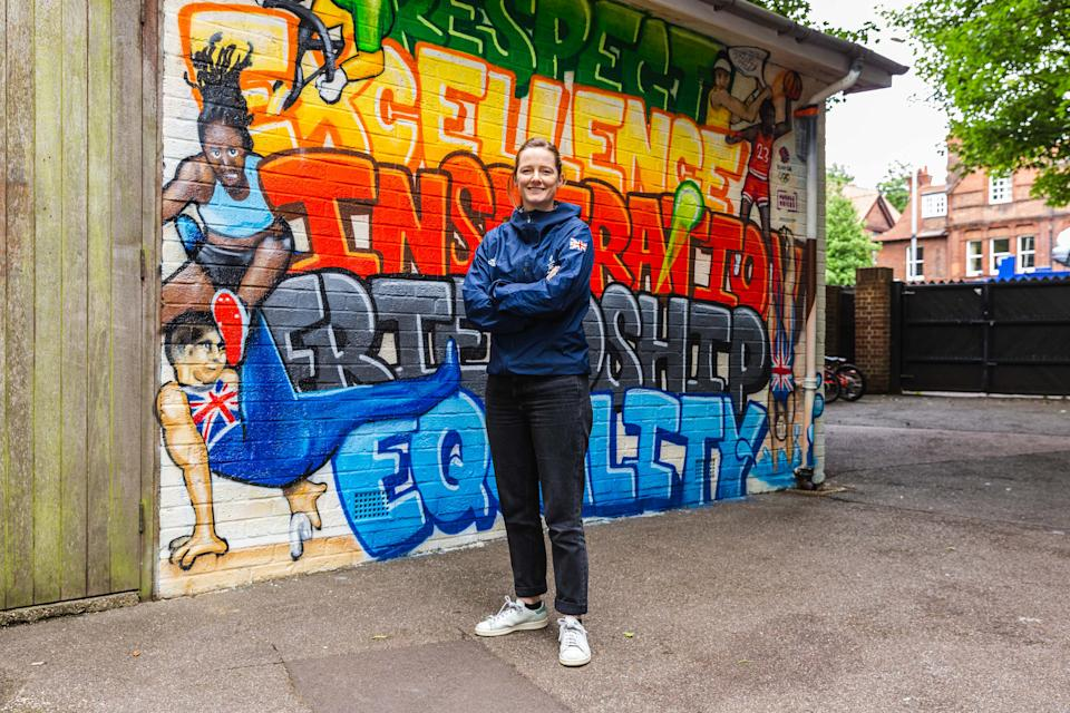 Helen Richardson-Walsh poses in front of the Purplebricks mural at St Alban's Catholic Primary School in Cambridge