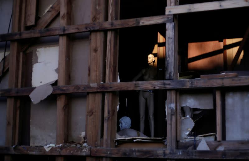 A mannequin is seen inside a building damaged by Hurricane Laura the day after Hurricane Delta swept through Lake Charles