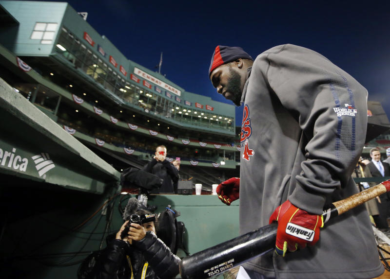 Boston Red Sox designated hitter David Ortiz walks into the dugout after a workout at Fenway Park in Boston, Tuesday, Oct. 29, 2013. The Red Sox are scheduled to host the St. Louis Cardinals in Game 6 of baseball's World Series on Wednesday. (AP Photo/Elise Amendola)