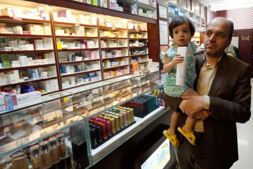 An Iranian man shops at a drugstore at the Nikan hospital in Tehran on September 11, 2018 before the International Court of Justice ruled on Wednesday October 3 that the US should suspend sanctions and allow free exports of medicines