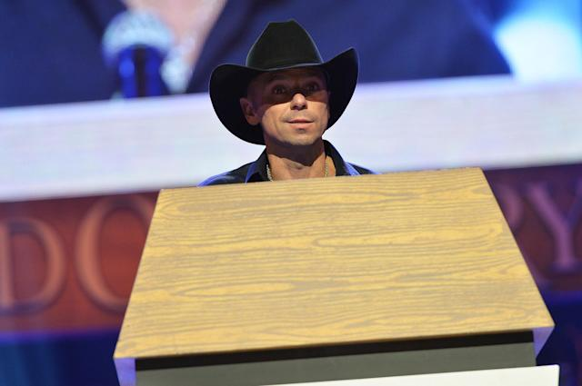 NASHVILLE, TN - MAY 02: (EXCLUSIVE COVERAGE) Country singer Kenny Chesney speaks at the funeral service for George Jones at The Grand Ole Opry on May 2, 2013 in Nashville, Tennessee. Jones passed away on April 26, 2013 at the age of 81. (Photo by Rick Diamond/Getty Images for GJ Memorial)