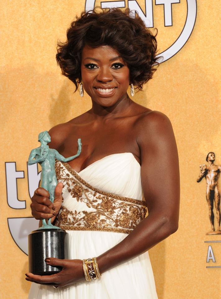 LOS ANGELES, CA - JANUARY 29:  Actress Viola Davis poses in the press room with her award for Outstanding Performance By A Cast In A Motion Picture for 'The Help' during the 18th Annual Screen Actors Guild Awards at The Shrine Auditorium on January 29, 2012 in Los Angeles, California.  (Photo by Jason Merritt/Getty Images)