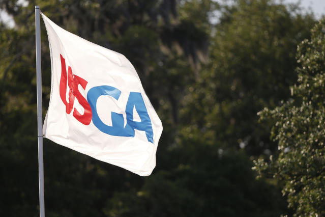 The USGA flag flies near the 18th green during the third round of the U.S. Women's Open golf tournament, Saturday, June 1, 2019, in Charleston, S.C. (AP Photo/Mike Stewart)