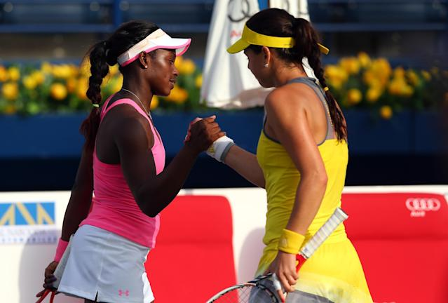 DUBAI, UNITED ARAB EMIRATES - FEBRUARY 18: Sorana Cirstea of Romania (R) is congratulated by Sloane Stephens of USA after Cirstea won in three sets during day one of the WTA Dubai Duty Free Tennis Championship on February 18, 2013 in Dubai, United Arab Emirates. (Photo by Julian Finney/Getty Images)