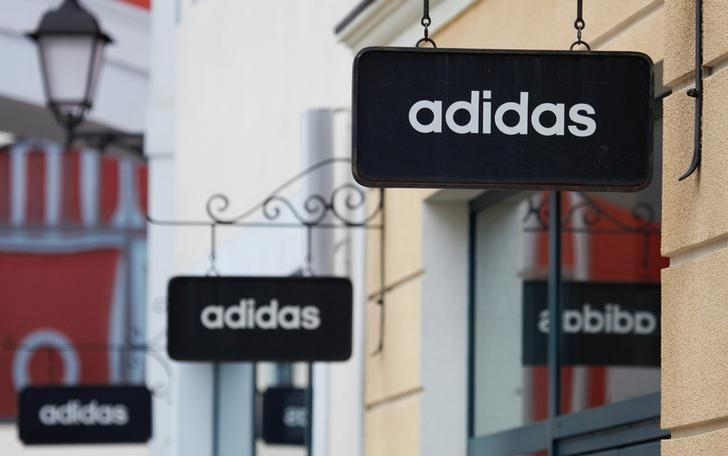 Boards With Adidas Store Logo Are Seen On A Shopping Center At The Outlet Village Belaya