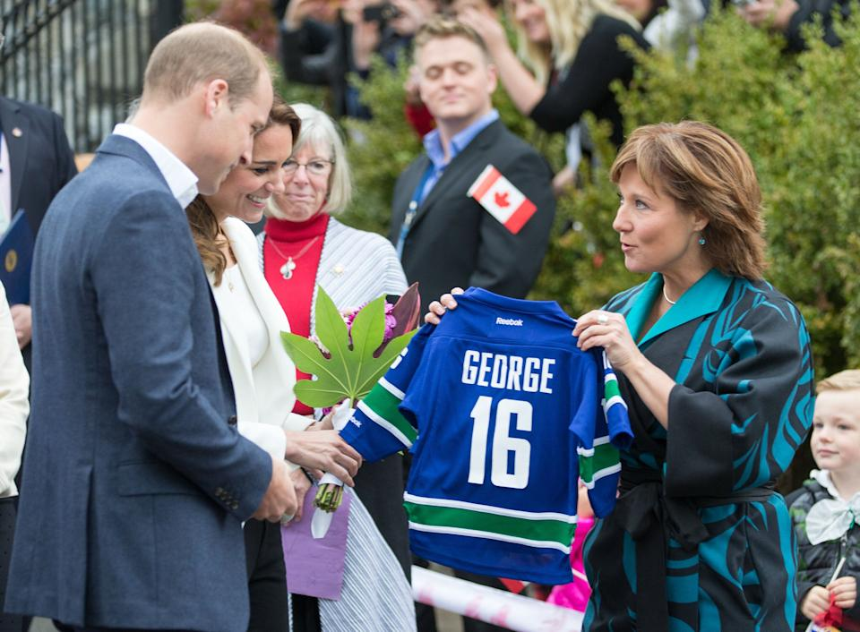 Catherine, Duchess of Cambridge and Prince William, Duke of Cambridge are given a gift for their son George as they visit the Cridge Centre for the Family on Oct. 1, 2016 in Victoria, B.C. during a royal tour of Canada. (Photo: Pool/Samir Hussein via Getty Images)