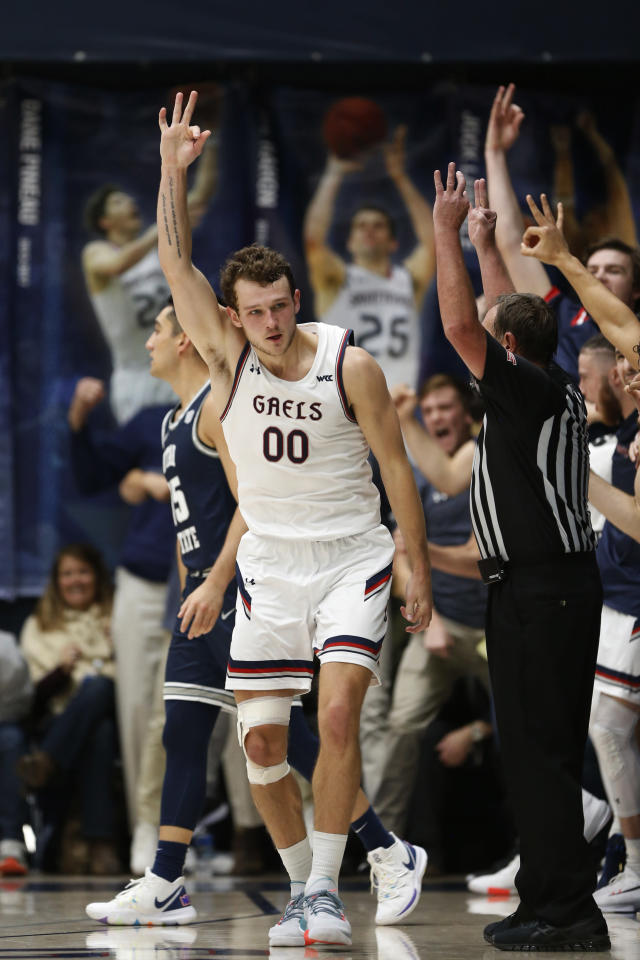 Saint Mary's forward Tanner Krebs (00) celebrates after making a 3-point shot against Utah State during the second half of an NCAA college basketball game in Moraga, Calif., Friday, Nov. 29, 2019. (AP Photo/Jed Jacobsohn)