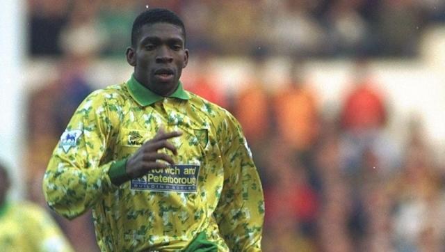 <p>Efan Ekoku was close. Efan Ekoku was SO close. The Nigeria international became the first player to score four goals in a Premier League game when he dismantled Everton in 1993 - his first three forming a perfect hat-trick (in order: right foot, head, left foot).</p> <br><p>That first goal came just before half-time though, so although he hit a perfect hat-trick and a German hat-trick in the same game, the order of his second half goals (head, left foot, left foot) means that he's the only man to score non-synchronous perfect and German hat-tricks in the same match. </p> <br><p>He remains, no doubt, devastated. </p>