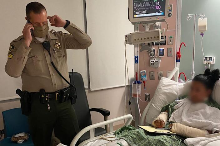 """<div class=""""inline-image__caption""""><p>Claudia Apolinar, who is unable to speak after the shooting, relays messages to a sheriff on the phone to President Donald Trump.</p></div> <div class=""""inline-image__credit"""">Los Angeles County Sheriff's Department</div>"""