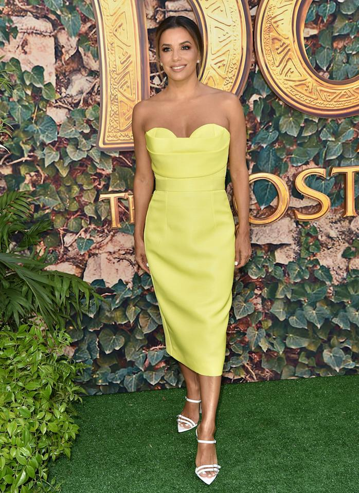For the star-studded premiere, Eva Longoria shone in a sunshine yellow dress by Brazilian designer, Vitor Zerbinato. <em>[Photo: Getty]</em>
