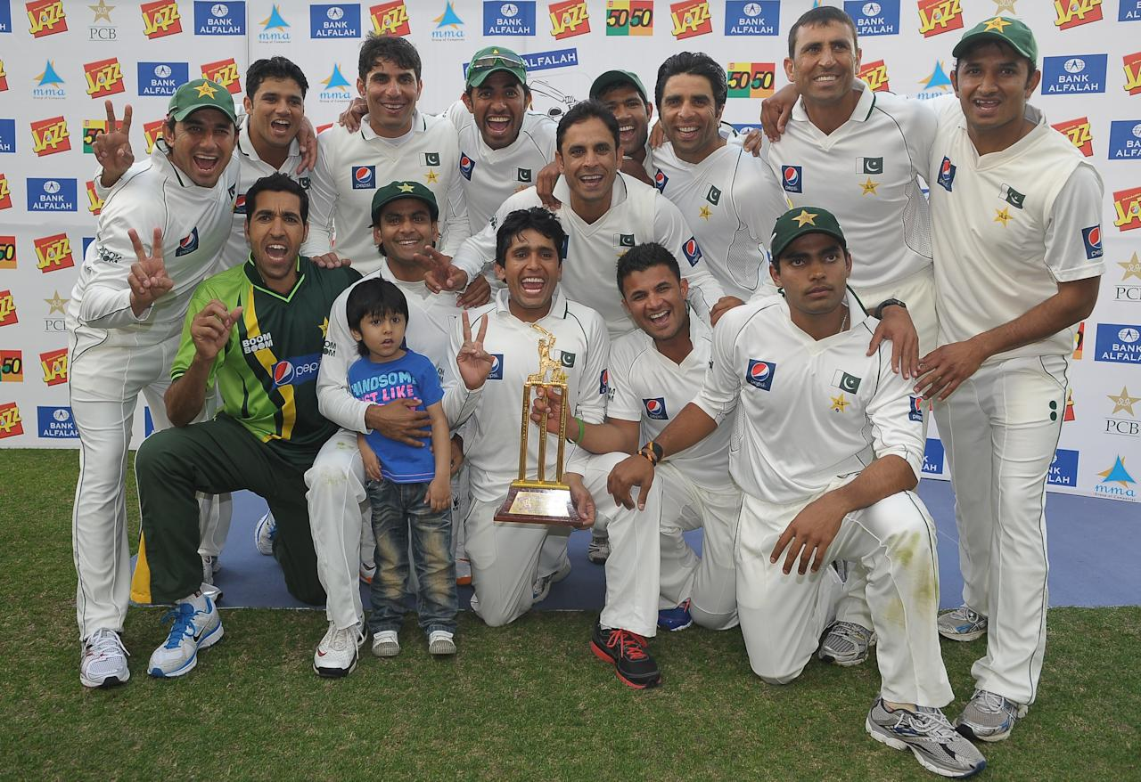 Pakistan's cricketers pose for photographers after  their victory in the third and final Test match between Pakistan and England at the Dubai International Cricket Stadium at Dubai Sports City on February 6, 2012. Pakistan beat England by 71 runs in the third and final Test to sweep the series 3-0 on the fourth day at Dubai Stadium. England were dismissed for 252 in their second innings as they slumped to a first-ever series whitewash against their opponents.For Pakistan it was a fifth series whitewash, their last coming in a 3-0 triumph over Bangladesh in 2003. AFP PHOTO/ LAKRUWAN WANNIARACHCHI (Photo credit should read LAKRUWAN WANNIARACHCHI/AFP/Getty Images)