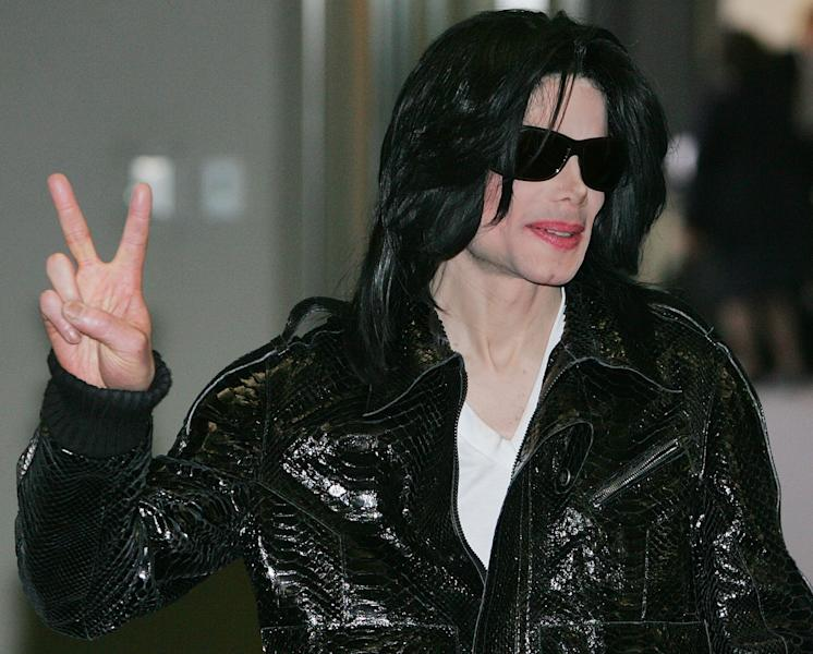 FILE - In this March 7, 2007 file photo, pop star Michael Jackson flashes a V-sign to Japanese media upon his arrival at Narita international airport, near Tokyo. Jurors in a negligent hiring lawsuit filed by Jackson's mother against the promoters of her son's comeback shows heard the company's top executive testify on Thursday June 6, 2013, that he didn't consult a mental health professional for the entertainer, despite the recommendations he do so from two high-level tour workers. (AP Photo/Itsuo Inouye, File)