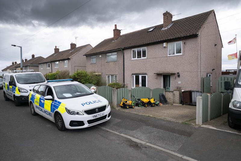 Police and forensics outside the house of the couple in Barnsley (Picture: SWNS)