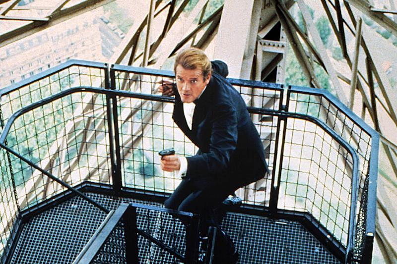 Roger Moore as 007 James Bond on the steps of the Eiffel Tower in A View to a Kill 1985: Sportsphoto/Allstar/Cinetext Collection