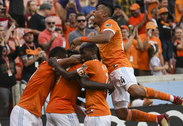 Houston Dynamo players celebrating Alberth Elis' goal against the Vancouver Whitecaps during the first half of an MLS soccer match Saturday, March 10, 2018, in Houston. (Yi-Chin Lee/Houston Chronicle/via AP)