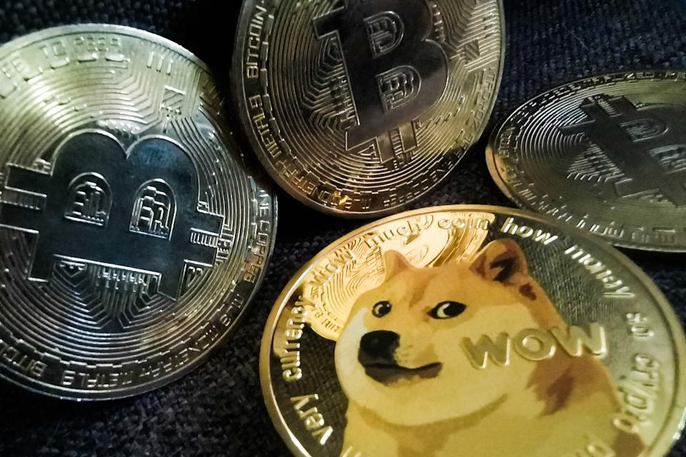 Representation of Bitcoin and Dogecoin cryptocurrencies are seen in this illustration photo taken in Sulkowice, Poland on August 10, 2021. (Photo Illustration by Jakub Porzycki/NurPhoto via Getty Images)