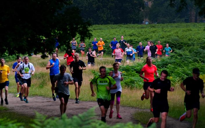 Runners taking part in the Parkrun at Bushy Park in London, the largest and oldest Parkrun in the UK, and one of many runs taking place across the country for the first time since last March. - Victoria Jones/PA Wire