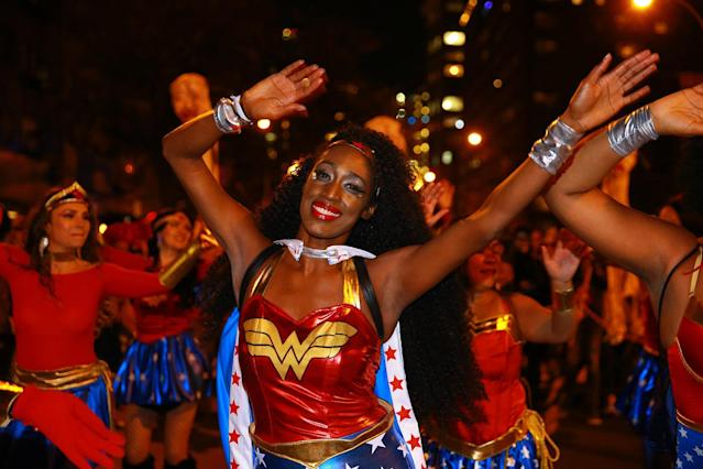 <p>A group of ladies dressed as Wonder Woman dance in the streets at the 44th annual Village Halloween Parade in New York City on Oct. 31, 2017. (Photo: Gordon Donovan/Yahoo News) </p>