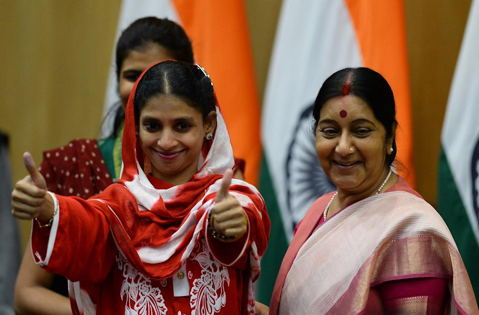 File Photo: Geeta (L) gestures as she stands alongside Sushma Swaraj after a press conference in New Delhi on October 26, 2015. (SAJJAD HUSSAIN/AFP via Getty Images)
