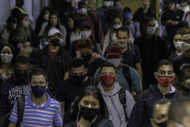 Commuters in face masks in Sao Paulo, Brazil, where thousands of new coronavirus cases have been reported (Sipa USA)