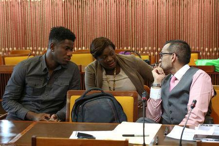 Former Jamaican world championship relay medallist Riker Hylton (L), his sister Tanisher (C) and his attorney Emir Crowne sit during a panel after filing an application to have Hylton's provisional ban for breaching anti-doping rules dismissed, in Kingston, Jamaica March 30, 2017. REUTERS/Gilbert Bellamy