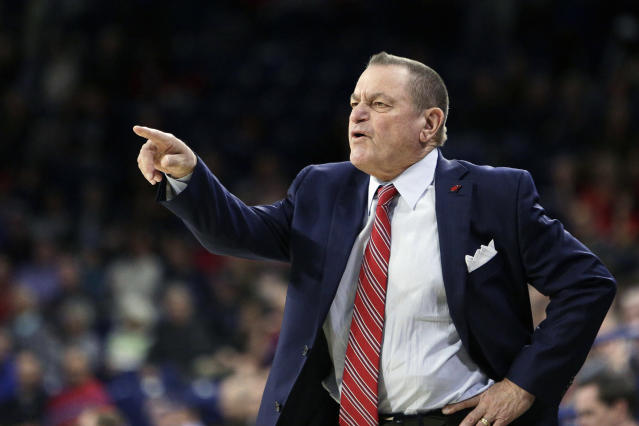 FILE - In this Nov. 29, 2017, file photo, Incarnate Word head coach Ken Burmeister directs his team during the first half of an NCAA college basketball game against Gonzaga in Spokane, Wash. Burmeister, a college basketball coach for 21 seasons who took Texas-San Antonio to the NCAA Tournament and later guided Loyola of Chicago, died Tuesday, May 19, 2020. He was 72. Loyola said Burmeister died following a bout with cancer. (AP Photo/Young Kwak, File)