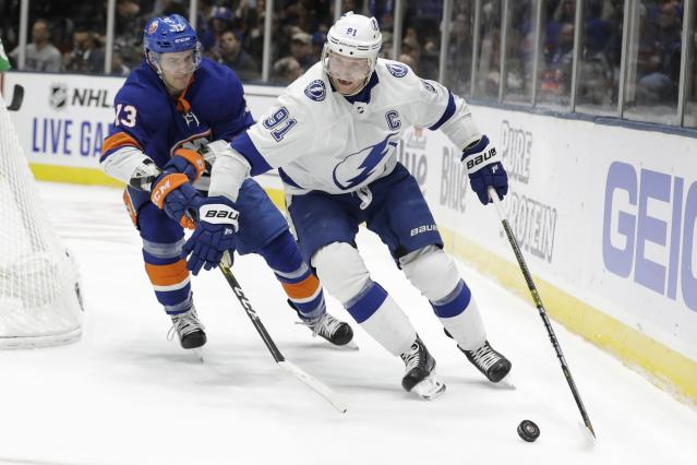New York Islanders' Mathew Barzal (13) defends against Tampa Bay Lightning's Steven Stamkos (91) during the first period of an NHL hockey game Friday, Nov. 1, 2019, in Uniondale, N.Y. (AP Photo/Frank Franklin II)