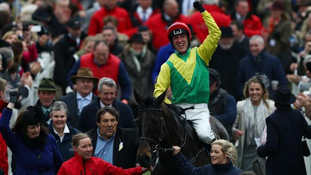 The Gold Cup was claimed by Sizing John on a St Patrick's Day dominated by the Irish at Cheltenham.