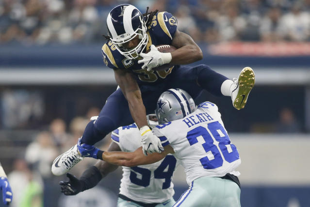 <p>Los Angeles Rams running back Todd Gurley (30) hurdles over Dallas Cowboys safety Jeff Heath (38) in the third quarter at AT&T Stadium. Mandatory Credit: Tim Heitman-USA TODAY Sports </p>
