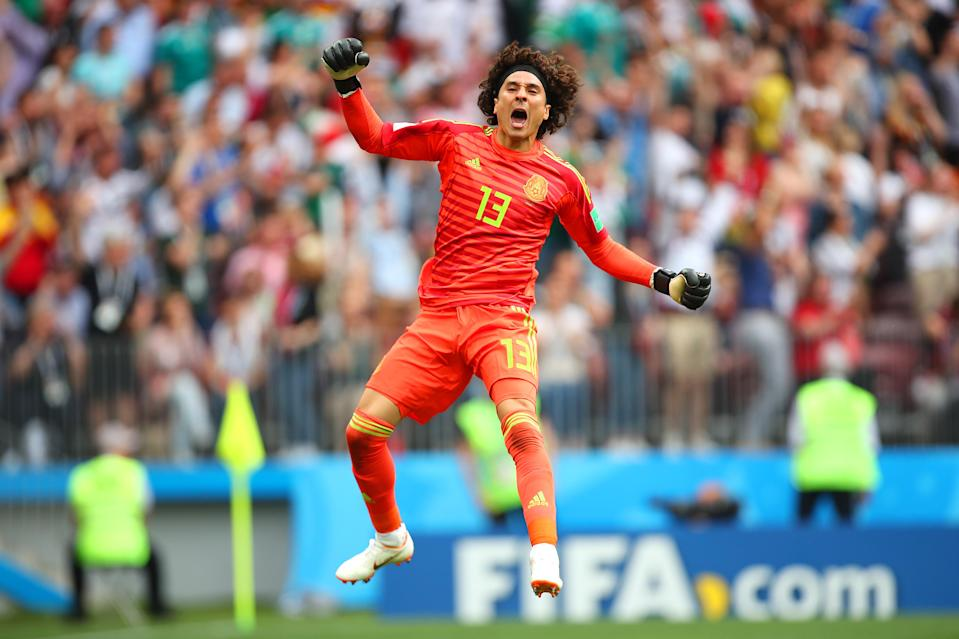 <p>Guillermo Ochoa of Mexico celebrates after Hirving Lozano scored a goal to make it 0-1 during the 2018 FIFA World Cup Russia group F match between Germany and Mexico at Luzhniki Stadium on June 17, 2018 in Moscow, Russia. (Photo by Robbie Jay Barratt – AMA/Getty Images) </p>