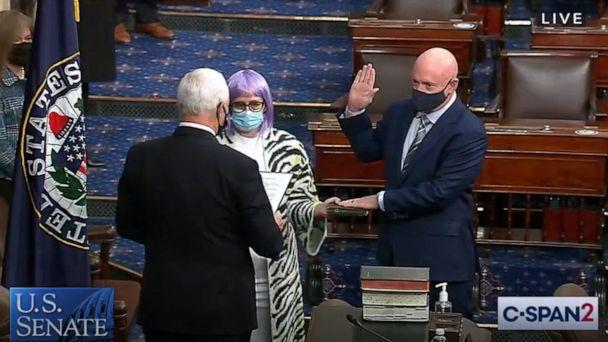 PHOTO: Mark Kelly is sworn in as Arizona's newest senator by Vice-President Mike Pence while standing next former Arizona congresswoman Gabrielle Giffords on the Senate floor in Washington, Dec. 2, 2020. (C-SPAN)
