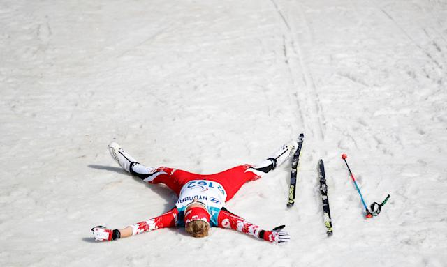 Cross-Country Skiing - Pyeongchang 2018 Winter Paralympics - Women's 1.5km Sprint Classic - Standing - Final - Alpensia Biathlon Centre - Pyeongchang, South Korea - March 14, 2018 - Natalie Wilkie of Canada makes a snow angel as she celebrates winning the bronze in the event. REUTERS/Carl Recine