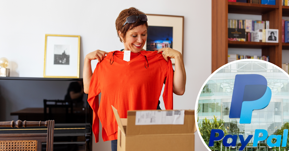 A woman holds up her online purchase and the PayPal logo in the corner.