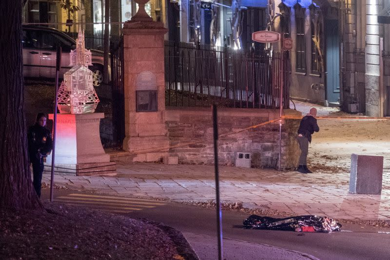 Police officers search an area where multiple people were stabbed in Quebec City