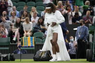 Serena Williams of the US walks onto Centre Court for the women's singles first round match against Aliaksandra Sasnovich of Belarus on day two of the Wimbledon Tennis Championships in London, Tuesday June 29, 2021. (AP Photo/Kirsty Wigglesworth)